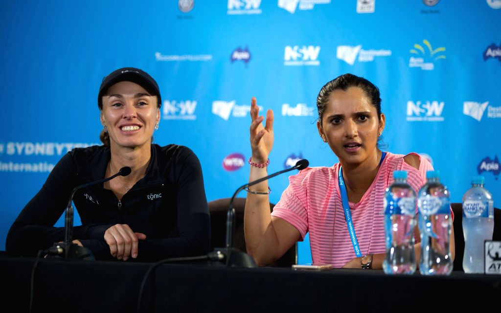 SYDNEY, Jan. 14?2016 Hingis of Switzerland (L) and Mirza of India are at press conference after the match in Sydney, Australia, Jan. 14, 2016. Hingis and Mirza won 2-1 against Olaru and ...