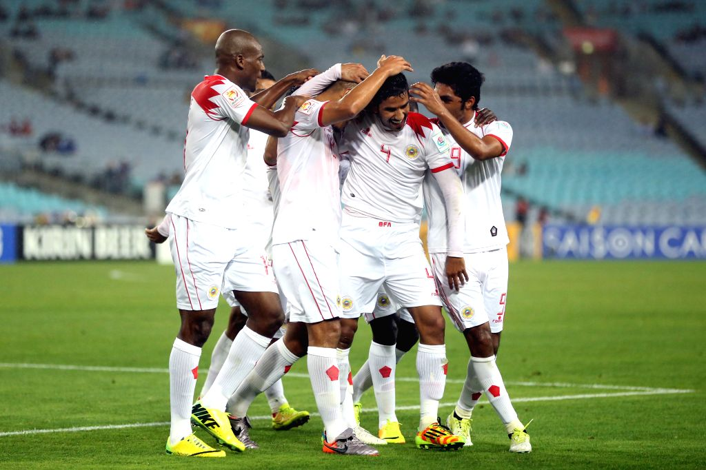 Players of Bahrain celebrate after scoring against Qatar during their Group C match at the AFC Asian Cup in Sydney, Australia, Jan. 19, 2015. Bahrain won 2-1. Both ...