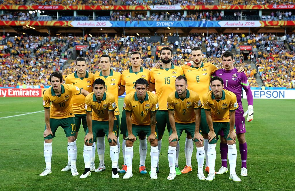 Australian players pose before their final match against South Korea at the 2015 AFC Asian Cup in Sydney, Australia, Jan. 31, 2015.
