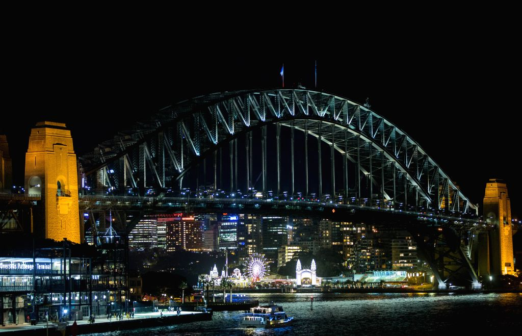 SYDNEY, July 15, 2016 - Photo taken on July 15, 2016 shows the national flag of France flying on top of the Sydney Harbour Bridge for the victims of the Nice terrorist attack in Sydney, Australia. ...