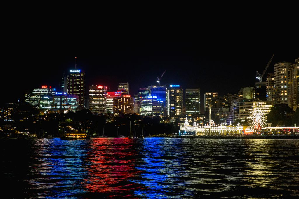 SYDNEY, July 15, 2016 - Photo taken on July 15, 2016 shows the city light of north Sydney showing the colors of French national flag in Sydney, Australia. The death toll rises to 84 from an attack in ...
