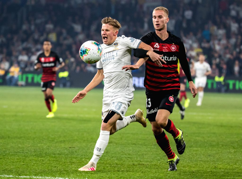 SYDNEY, July 20, 2019 - Mateusz Bogusz (L, front) of Leeds United competes during an international friendly football match between Western Sydney Wanderers and Leeds United in Sydney, Australia on ...