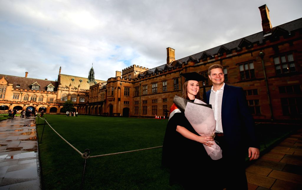 SYDNEY, June 17, 2019 - Graduates pose for photos at the campus of University of Sydney, Australia, June 5, 2019. Introduced in 2010, Australia's move to a demand-driven higher education system has ...