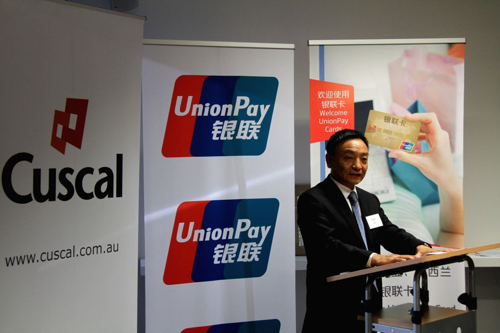 UnionPay President Shi Wenchao delivers a speech during the ceremony in Sydney, Australia, June 18, 2104. UnionPay International, the global arm of China UnionPay, ..