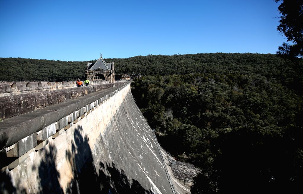 SYDNEY, June 2, 2019 - Staff walk on the dam of Cataract reservoir in Australia, May 31, 2019. Sydney reintroduced water usage restrictions last week as dam levels fall towards 50 percent capacity.