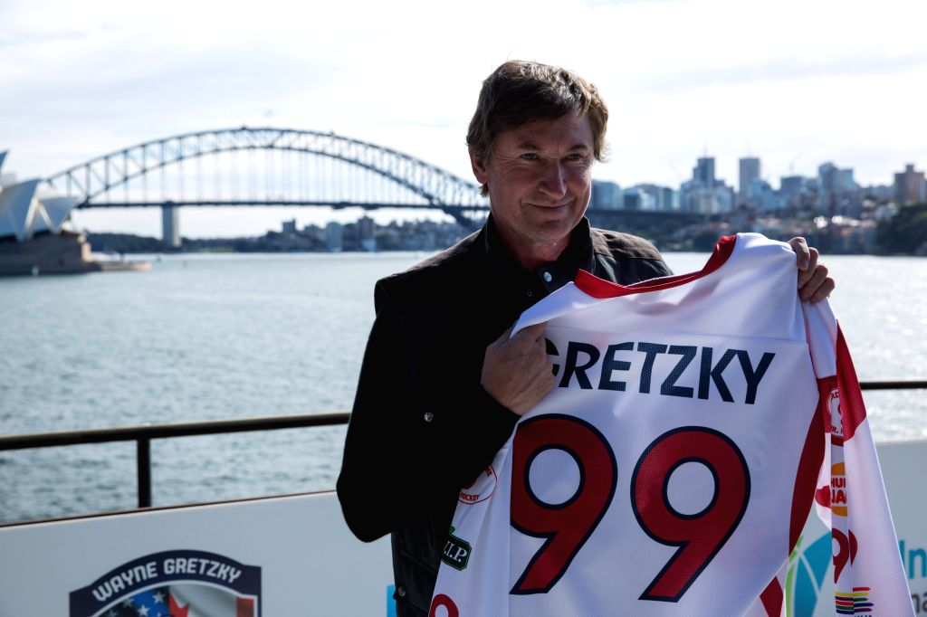 SYDNEY, June 23, 2016 - Ice Hockey player Wayne Gretzky poses for a photo holding his jersey in Sydney, Australia, June 23, 2016. Wayne Gretzky, the 55-year-old Canadian hockey legend, is in ...