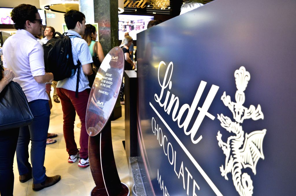 Customers wait in a queue in the Lindt Chocolate cafe, where the Sydney cafe siege happened on Dec. 15, 2014, in Sydney, Australia, March 20, 2015. The cafe was ...