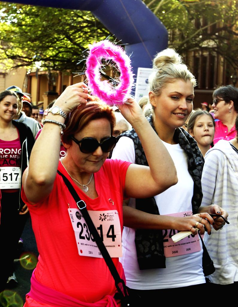 People attend the annual Mother's Day Classic fun run and walk event and fund raising for breast cancer research in Sydney, Australia, May 11, 2014.