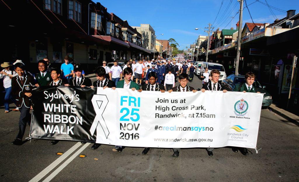SYDNEY, Nov. 25, 2016 - Sydneysiders participate in the Sydney White Ribbon Walk on the International Day for the Elimination of Violence Against Women in Sydney, Australia, Nov. 25, 2016. Scores of ...