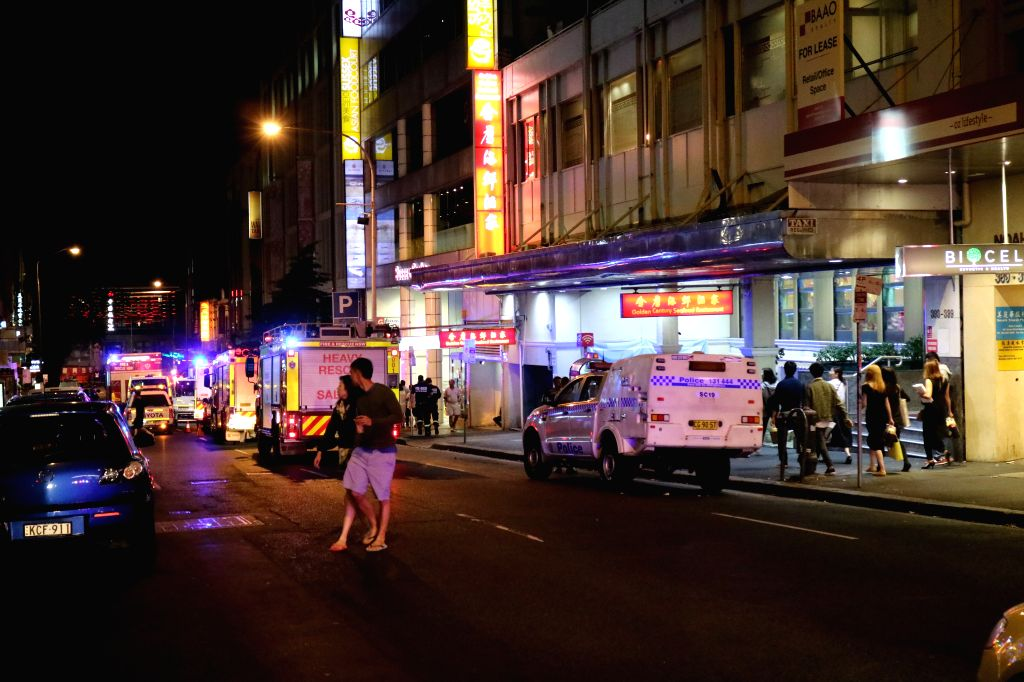 SYDNEY, Nov. 29, 2016 - Photo taken on Nov. 29, 2016 shows the scene outside an explosion site in Sydney, Australia. Fourteen people including two children were injured when a gas explosion blew out ...