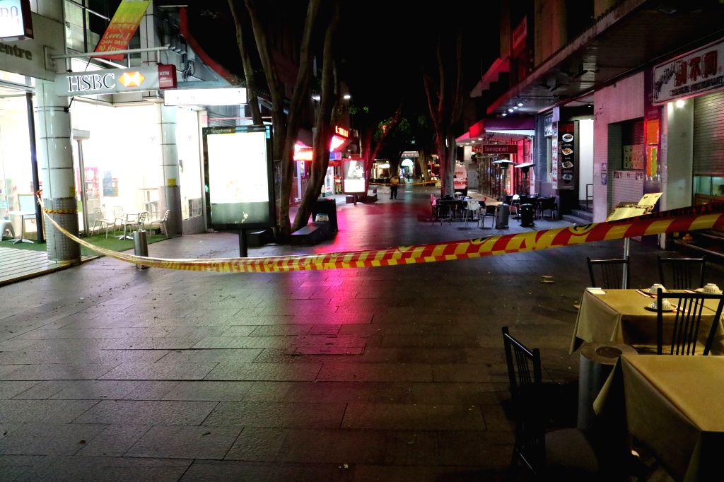SYDNEY, Nov. 29, 2016 - Photo taken on Nov. 29, 2016 shows an explosion site isolated by the police in Sydney, Australia. Fourteen people including two children were injured when a gas explosion blew ...