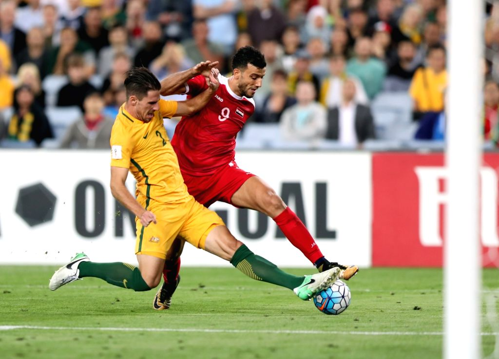 SYDNEY, Oct. 10, 2017 - Omar Alsoma (R) of Syria shoots during the FIFA World Cup 2018 Qualifiers Asian Playoff match between Australia and Syria at Sydney Olympic Stadium in Sydney, Australia, Oct. ...