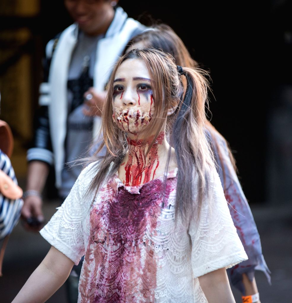 "SYDNEY, Oct. 29, 2016 - A disguised girl takes part in a ""Zombie Walk"" in Sydney, Australia, Oct. 29, 2016. People dressed as zombies participated in the Sydney Zombie Walk on Saturday to ..."