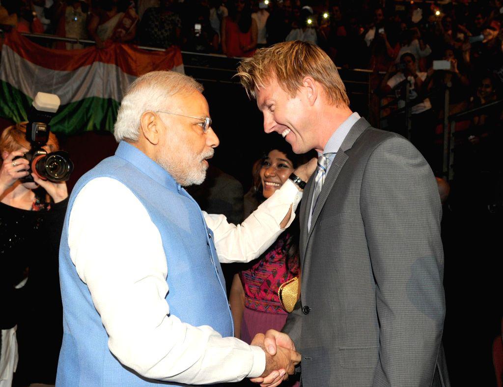 Prime Minister, Narendra Modi meets the Australian Cricketer Brett Lee at a Community Reception, held at Allphones Arena, in Sydney, Australia on Nov 17, 2014. - Narendra Modi