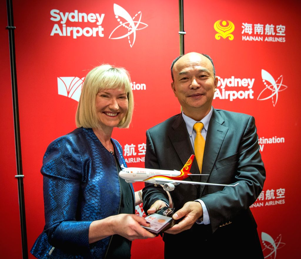 SYDNEY, Sept. 13, 2016 - Vice president of Hainan Airlines Pu Ming (R) gives a Hainan Airlines model to Sydney Airport Chief Executive Officer Kerrie Mather as a gift on the inaugural ceremony, in ...