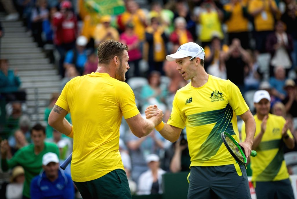 SYDNEY, Sept. 17, 2016 - Australia's Sam Groth (L) and John Peers celebrate after defeating Slovakia's Igor Zelenay and Andrej Martin during their Davis Cup World Group playoff doubles in Sydney, ...