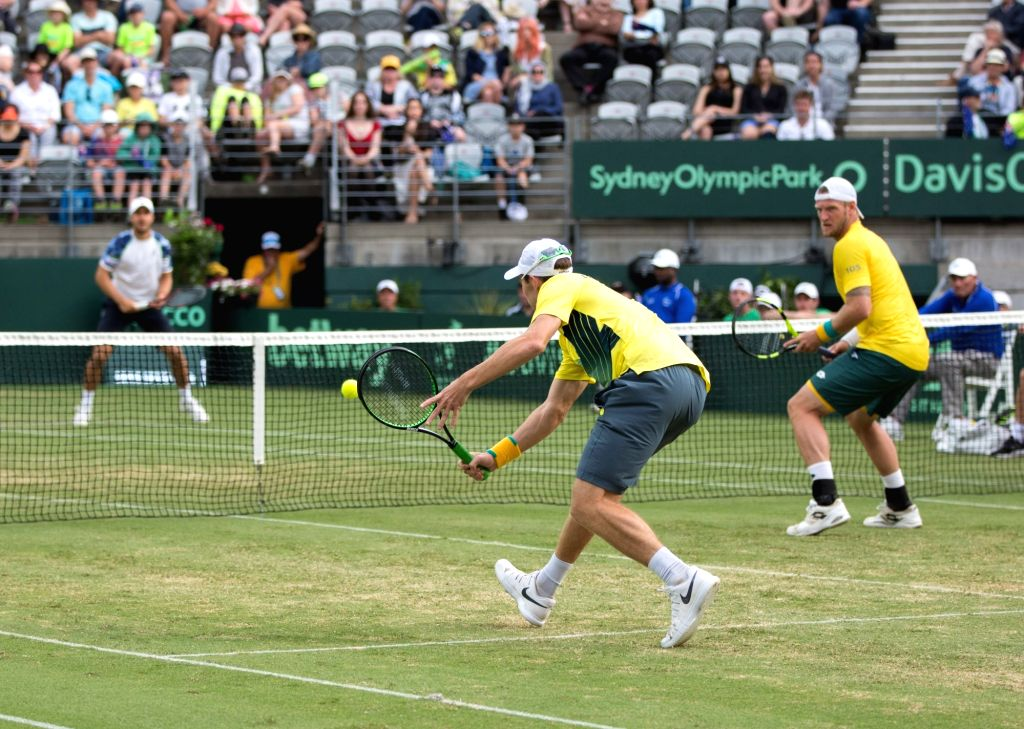 SYDNEY, Sept. 17, 2016 - Australia's Sam Groth (R) and John Peers compete against Slovakia's Igor Zelenay and Andrej Martin during their Davis Cup World Group playoff doubles in Sydney, Australia, ...