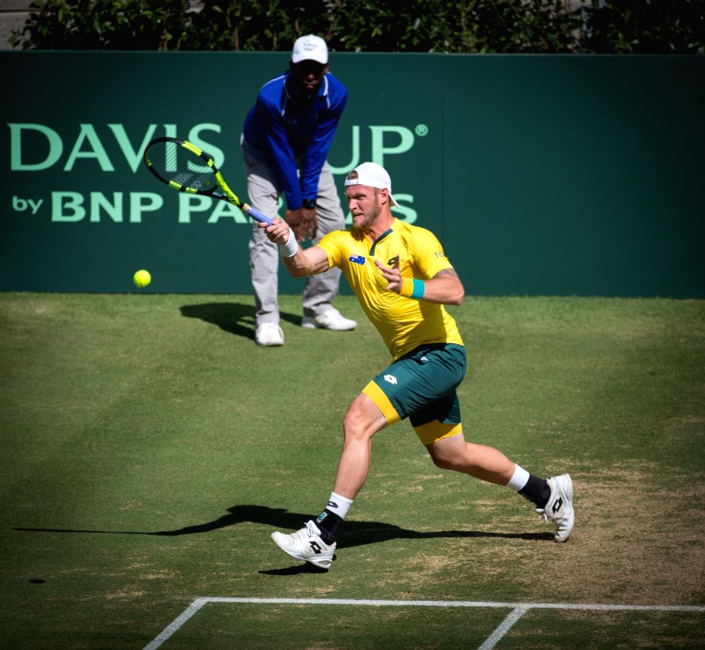 SYDNEY, Sept. 17, 2016 - Sam Groth (front) of Australia returns the ball to players of Solvakia during the Davis Cup World Group playoff in Sydney, Australia, Sept. 17, 2016. Australia won, 3-1.