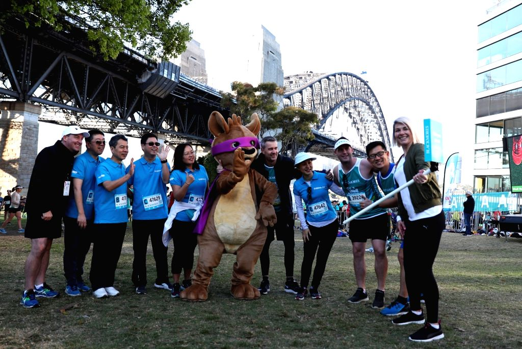 SYDNEY, Sept. 17, 2017 - Participants pose for pictures during the Bridge Run of the Sydney Running Festival in Sydney, Australia, on Sept. 17, 2017. Around 34,000 runners took part in the event.