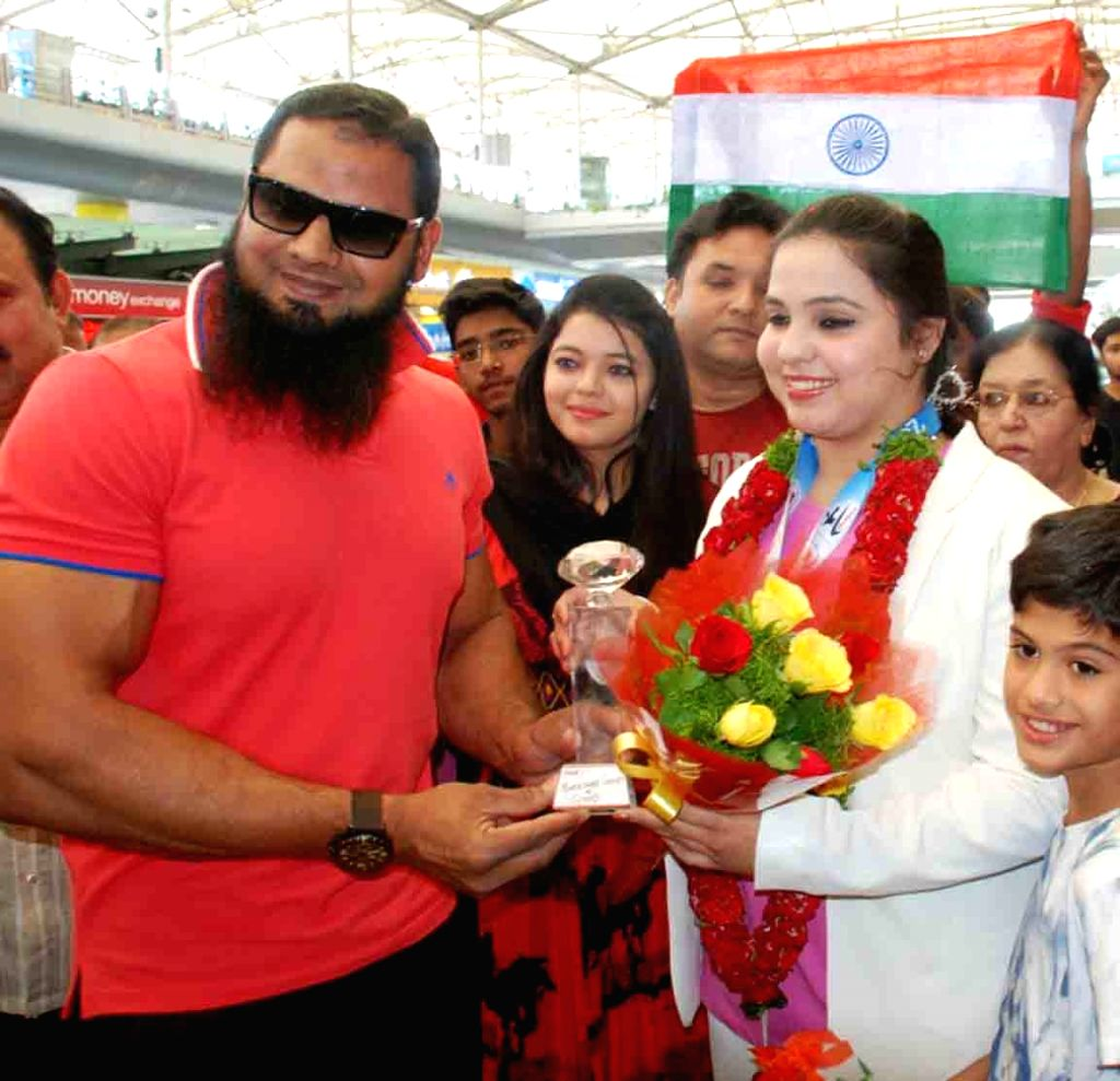 Syeda Falak won gold medal in the USA Open Karate Championship 2016 in the Senior Female Kumite category being greeted on her arrival in Hyderabad on April 11, 2016.