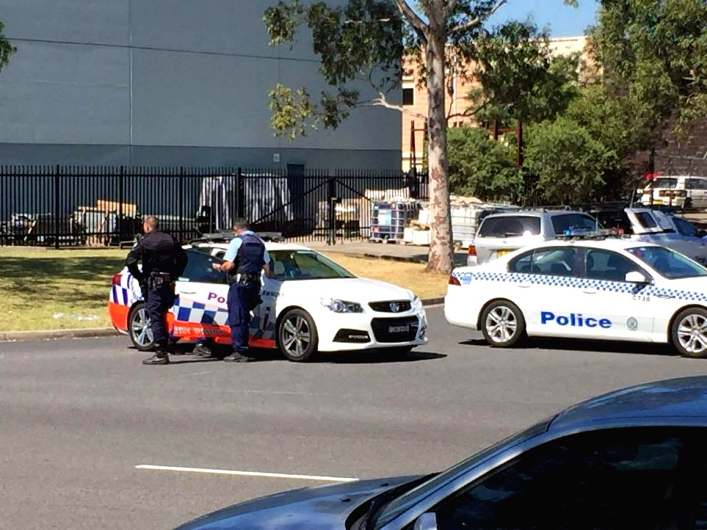 SYNDEY, March 7, 2016 (Xinhua) -- Policemen are seen near the scene of the shooting incident on the outskirts of Sydney, Australia, March 7, 2016. A man was killed and two others were injured and taken to a hospital following a shooting at a signage