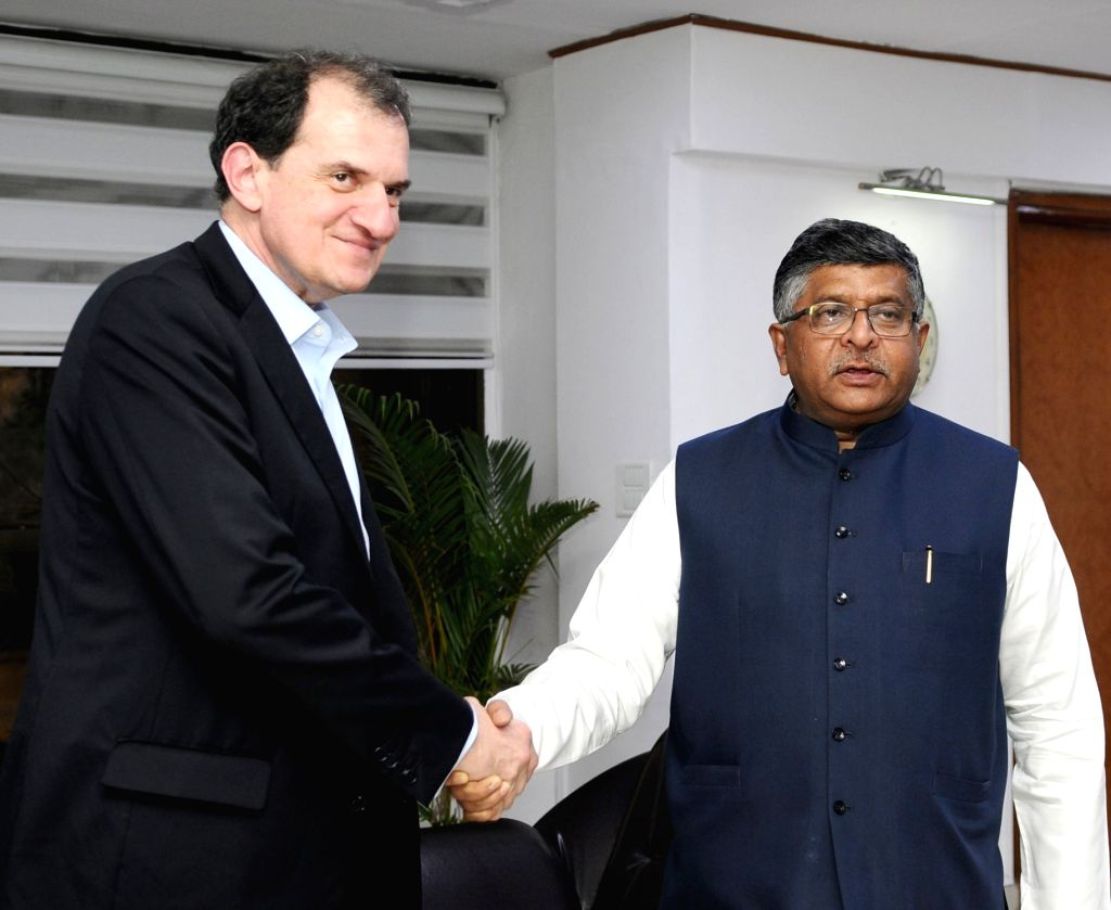 Syniverse Technologies Services Global CEO, Dean Douglas meets Union Electronics and Information Technology and Law and Justice Minister Ravi Shankar Prasad, in New Delhi on May 24, 2018. - Ravi Shankar Prasad