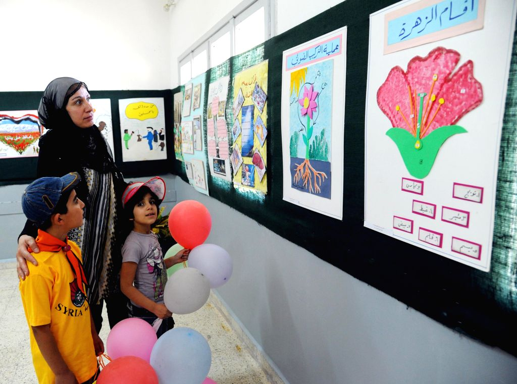 Syrian children take part in a festival for children held in the town of al-Nabek, countryside of Damascus, capital of Syria, on Aug. 17, 2015. Al-Nabek was ...