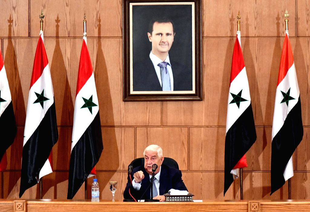 Syrian Foreign Minister Walid al-Moallem speaks during a press conference in Damascus, capital of Syria, on June 23, 2020. Syrian Foreign Minister Walid al-Moallem ... - Walid