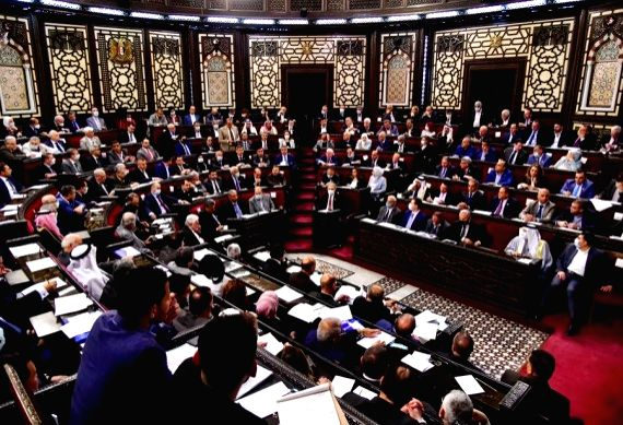 Syrian lawmakers attend a meeting at the parliament in Damascus, capital of Syria, on April 18, 2021.