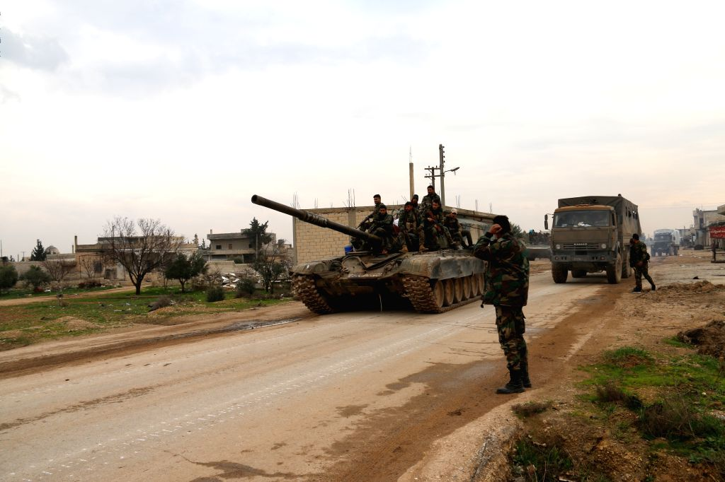 Syrian military personnel are seen in the town of Tal Toukan, the countryside of Idlib province in northwestern Syria on Feb. 5, 2020. The Syrian army succeeded to ...