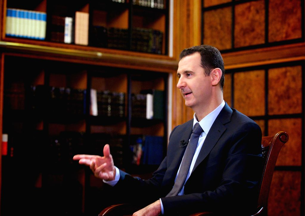 :Syrian President Bashar al-Assad receives an interview with Russia 24 channel in Damascus, capital of Syria, on Spet.12, 2013. Syrian President Bashar al-Assad ...