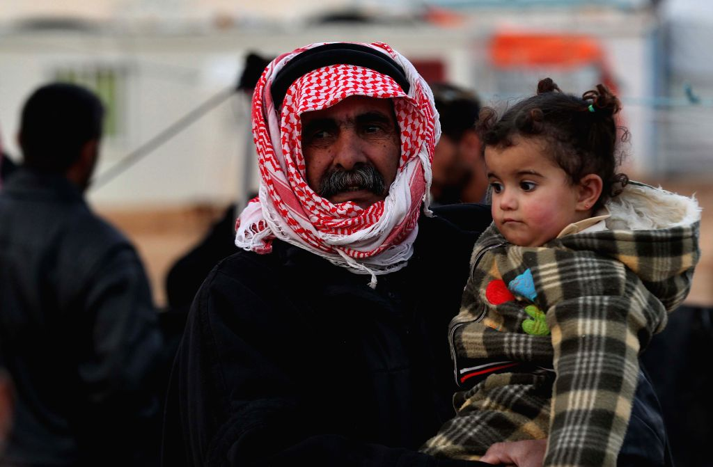 Syrian refugees are seen at Zattari Syrian refugee camp near the city of Mafraq, Jordan on Jan. 18, 2016.
