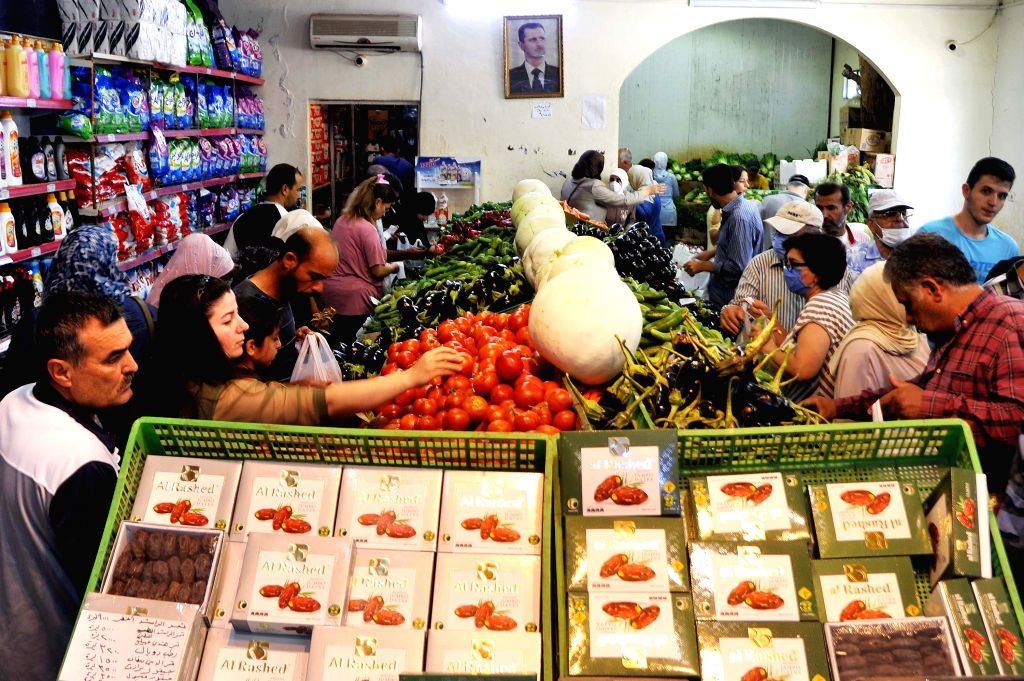Syrians do shopping at a grocery store in Damascus, capital of Syria, on June 25, 2020. The United States has recently imposed new sanctions on Syria under the ...