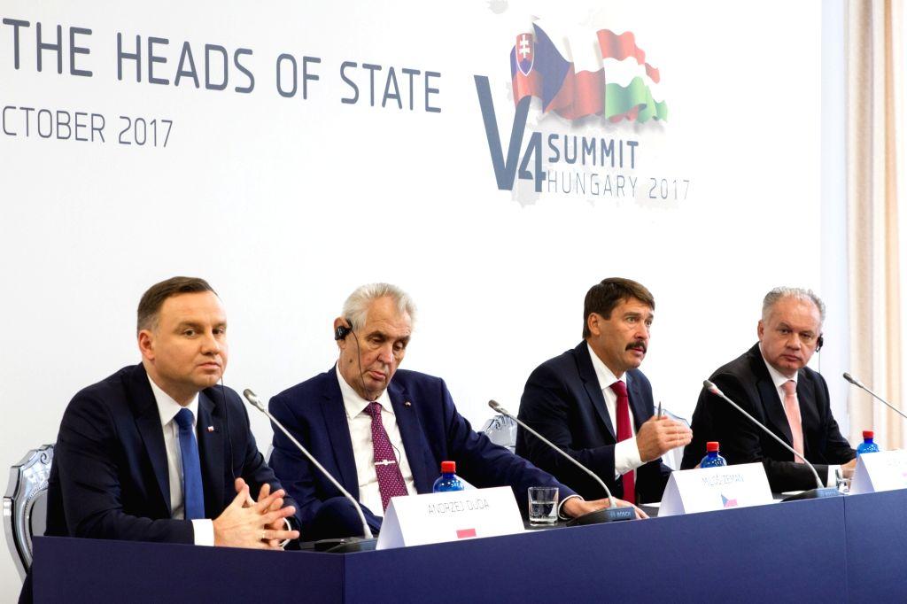 SZEKSZARD, Oct. 14, 2017 - Polish President Andrzej Duda, Czech President Milos Zeman, Hungarian President Janos Ader and Slovak President Andrej Kiska (L-R) hold a press conference after their ...