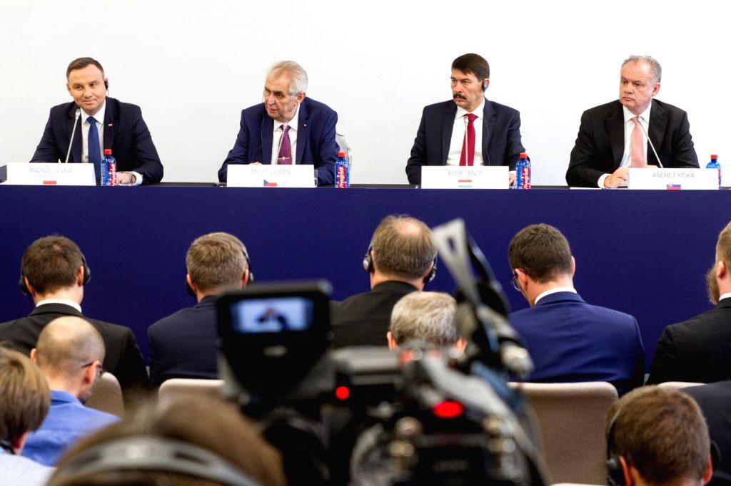 SZEKSZARD, Oct. 14, 2017 (Xinhua) -- Polish President Andrzej Duda, Czech President Milos Zeman, Hungarian President Janos Ader and Slovak President Andrej Kiska (L-R) hold a press conference after their summit meeting in Szekszard, southern Hungary,