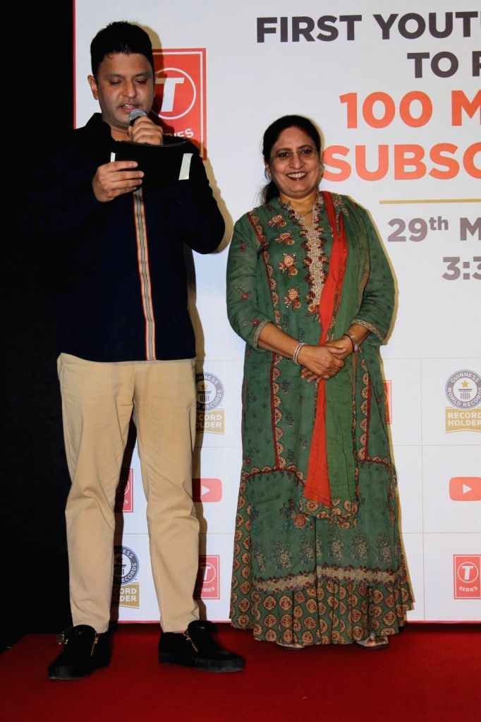 T-Series Chairman and Managing Director Bhushan Kumar and his mother-singer Sudesh Kumari during a programme, where music record label and film production company T-Series was officially ... - Bhushan Kumar