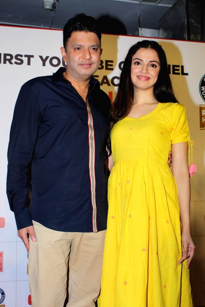 T-Series Chairman and Managing Director Bhushan Kumar and his wife-actress Divya Khosla Kumar during a programme, where music record label and film production company T-Series was officially ... - Divya Khosla Kumar and Bhushan Kumar