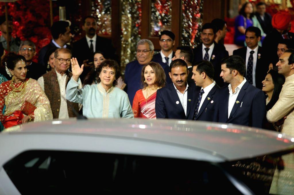 Tabla player Ustad Zakir Hussain at the wedding ceremony of industrialist Mukesh Ambani's daughter Isha Ambani and Anand Piramal at Antilia in Mumbai on Dec 12, 2018. - Mukesh Ambani and Isha Ambani