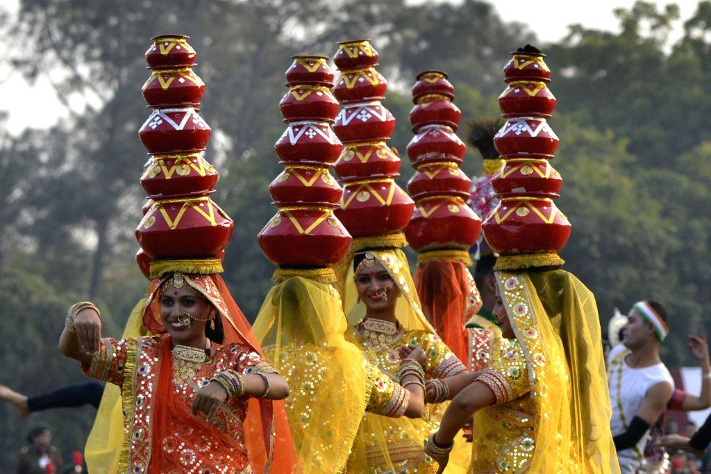 Tableau artistes perform during Prime Minister Narendra Modi's visit to meet NCC Cadets at Teen Murti Lawns in New Delhi on Jan 27, 2018. - Narendra Modi