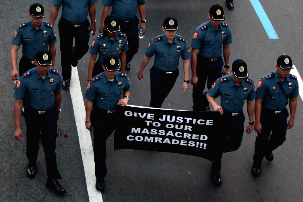"Members of the Philippine National Police (PNP) participate in the ""Walk for Sympathy and Justice"" for the 44 fallen comrades in Taguig City, the ..."