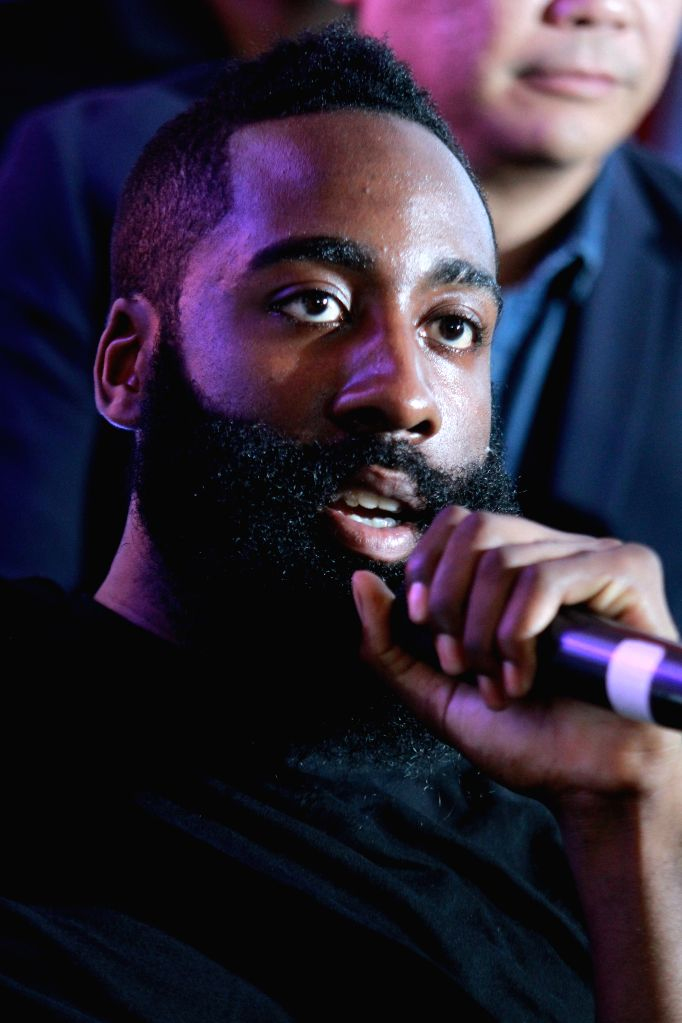 NBA basketball player James Harden of Houston Rockets replies to media during the Charity Event press conference in Taguig City, the Philippines, July 21, 2014.