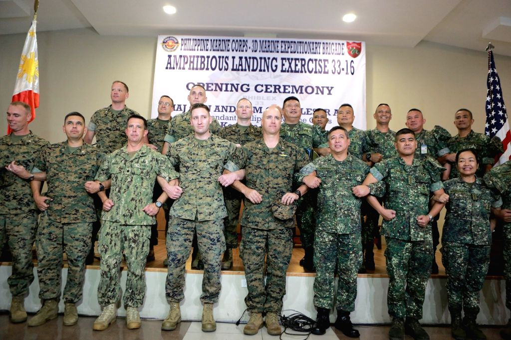 TAGUIG CITY, Oct. 4, 2016 - Officers from the U.S. and the Philippine Marine Corps pose for a group photo during the opening ceremony of the annual Philippines Amphibious Landing Exercise in Taguig ...