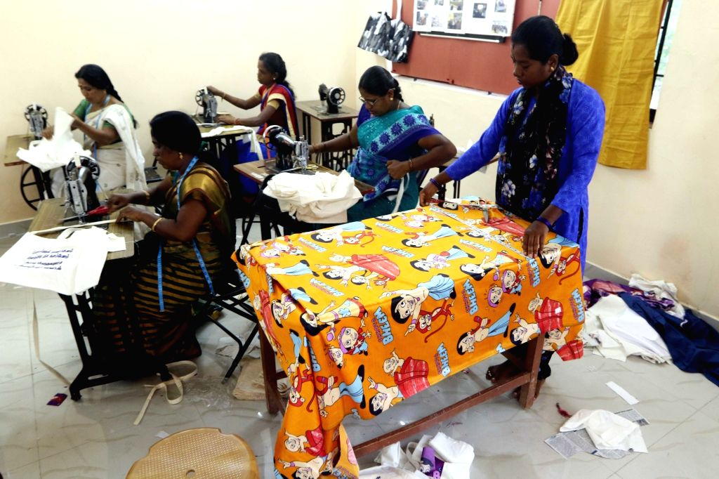 Tailors stitch biodegradable bags ahead of a plastic ban announced by the Tamil Nadu government, in Chennai on July 16, 2018. The state government recently issued orders that exempted ...