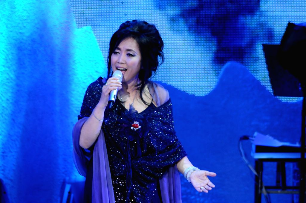 Singer Chyi Yu performs at her solo concert in Taipei, southeast China's Taiwan, April 11, 2014.