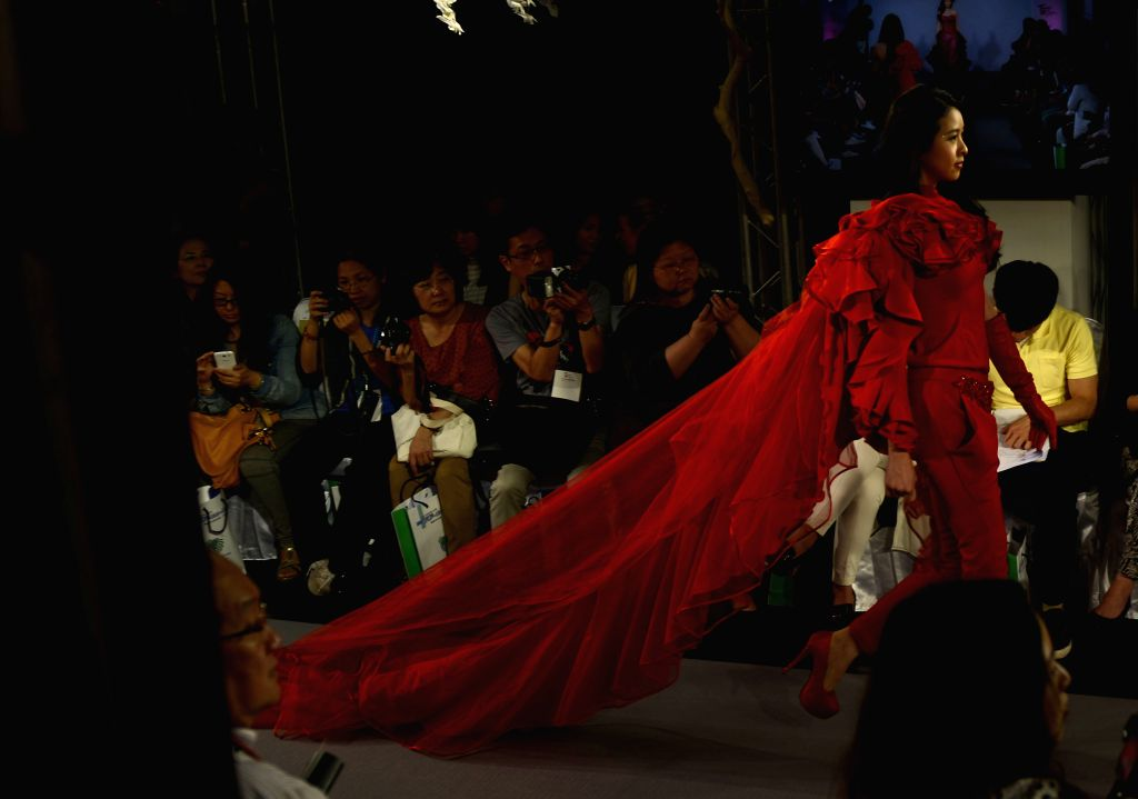 A model presents a creation at a press conference held for the fashion event Taipei IN Style at Songshan Culture and Creative Park in Taipei, southeast China's ...