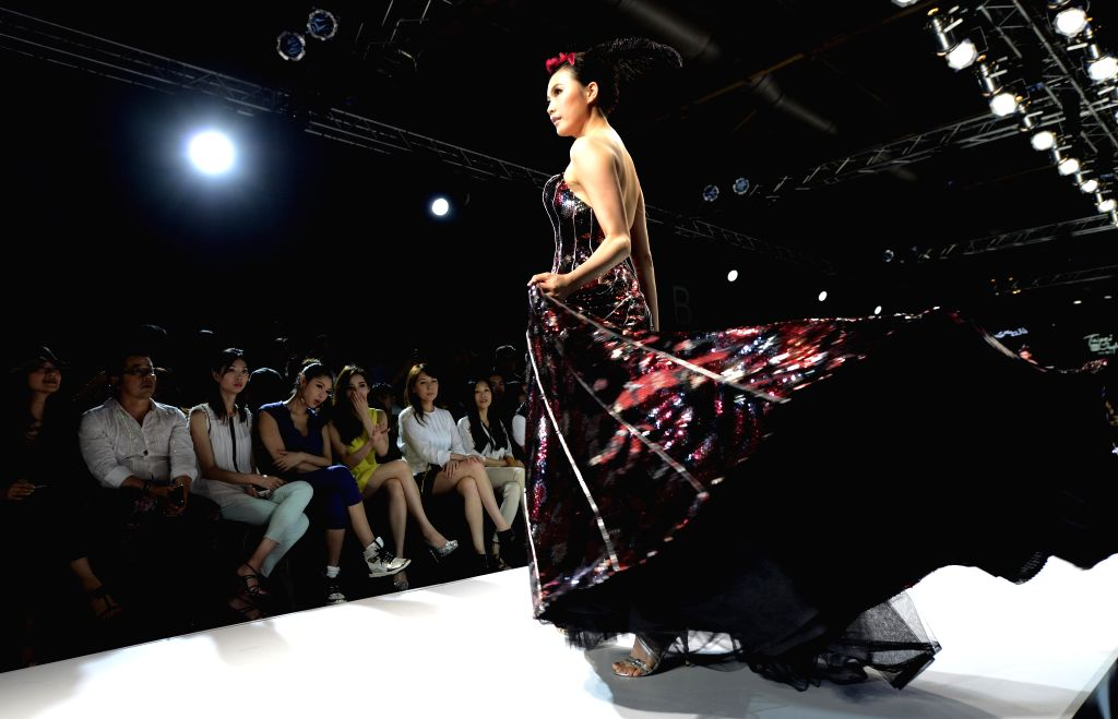 A model presents a creation during the fashion event Taipei IN Style in Taipei, southeast China's Taiwan, April 18, 2014.