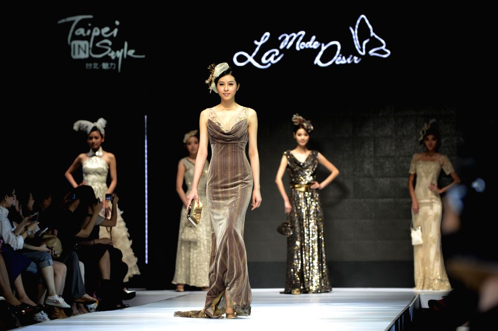 Models present creations during the fashion event Taipei IN Style in Taipei, southeast China's Taiwan, April 18, 2014.