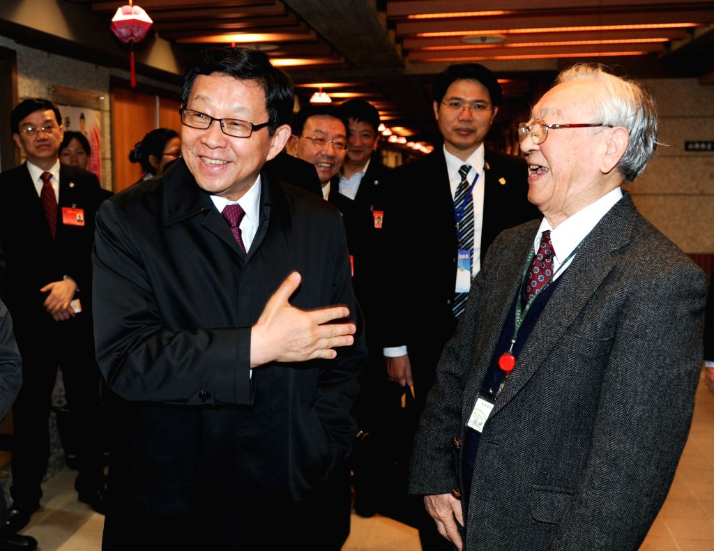 Chen Deming (L front), president of the mainland-based Association for Relations Across the Taiwan Strait (ARATS), talks with an elder during his visit to Chang Gung Culture Village in ...