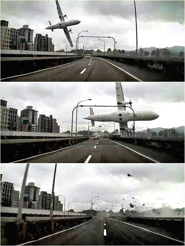 Combined photos taken by an automobile data recorder shows an airplane crashes over a bridge in Taipei, southeast China's Taiwan, Feb. 4, 2015. A plane of the Taiwan .