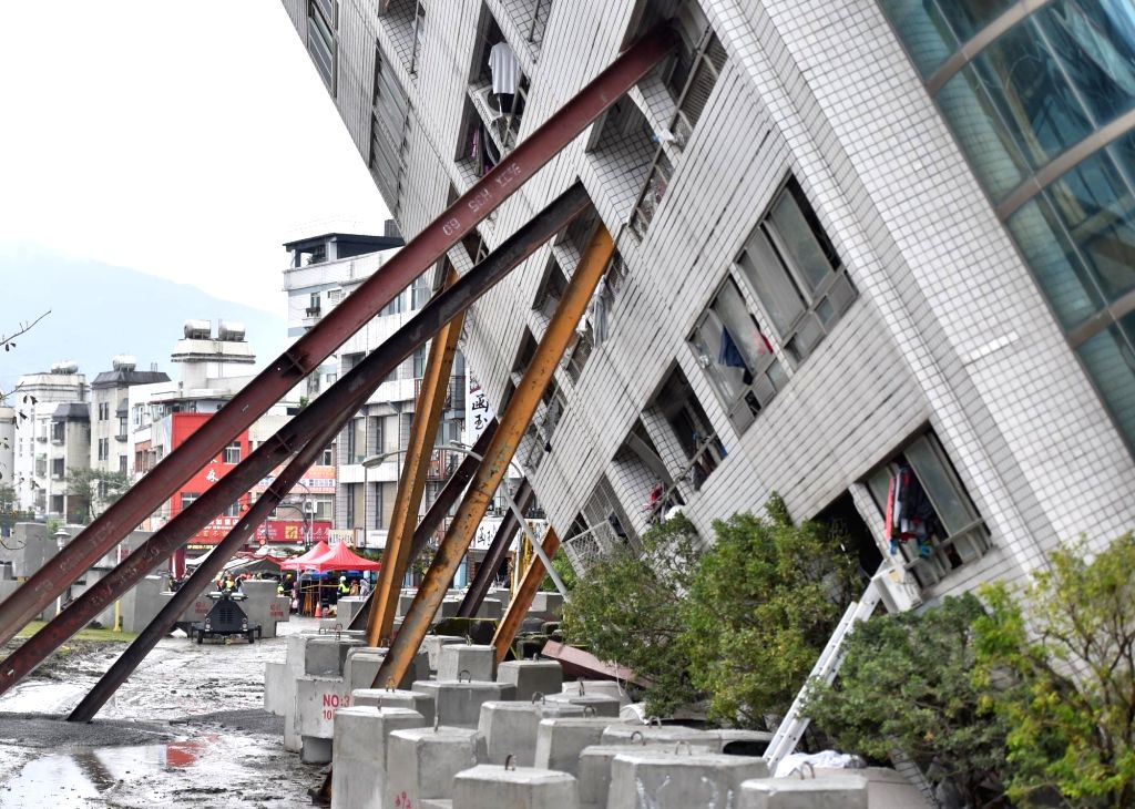TAIPEI, Feb. 8, 2018 - Photo taken on Feb. 8, 2018 shows the damaged Yun Men Tusi Ti building in Hualien, Taiwan. Four tourists from the mainland had been confirmed dead as of Thursday morning after ...